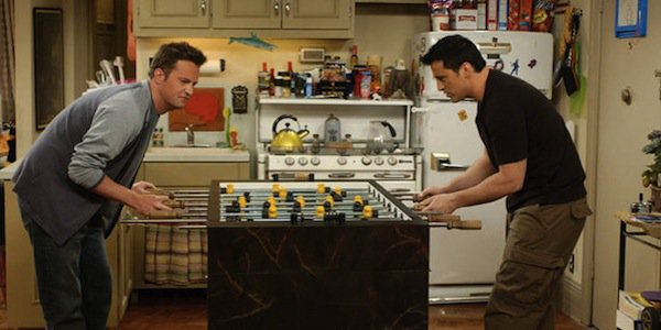 joey and chandler playing foosball